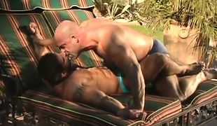 Mature muscle gays kiss each other outdoor