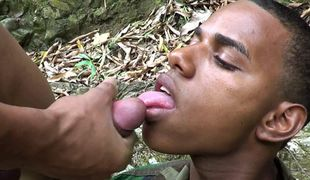 Army cock-sucker shoots a load outdoors