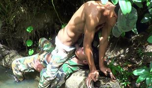 Camouflaged gay lovers go for a facial