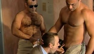Bear and muscle policemen seduce courier