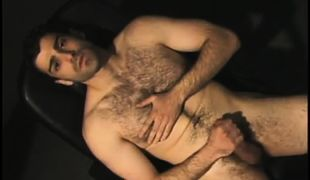 Bear gay man plays with cock