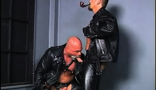 Old bear in leather sucks hard cock